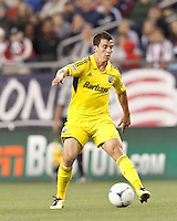 Columbus Crew substitute midfielder Bernardo Anor (7) passes the ball. In a Major League Soccer (MLS) match, the New England Revolution tied the Columbus Crew, 0-0, at Gillette Stadium on June 16, 2012.