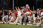 The UNLV sideline celebrates their victory against Nevada in the final seconds during the second half of an NCAA college football game in Reno, Nev., on Saturday, Oct. 26, 2013. UNLV defeated Nevada 27-22.<br /> (AP Photo/Cathleen Allison)