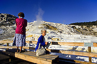 Tourists viewing Mammoth terrace in Yellowstone national Park, Wyoming, USA