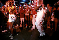 Samba school rehearsals reflect the party atmosphere that saturates every aspect of carnival. A young member of the Acadêmicos do Salgueiro group dances the sensuous samba with an older man<br />