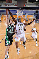 6 February 2010:  FIU's Marvin Roberts (11) and North Texas' Collin Mangrum (20) battle for a rebound in the first half as the North Texas Mean Green defeated the FIU Golden Panthers, 68-66, at the U.S. Century Bank Arena in Miami, Florida.