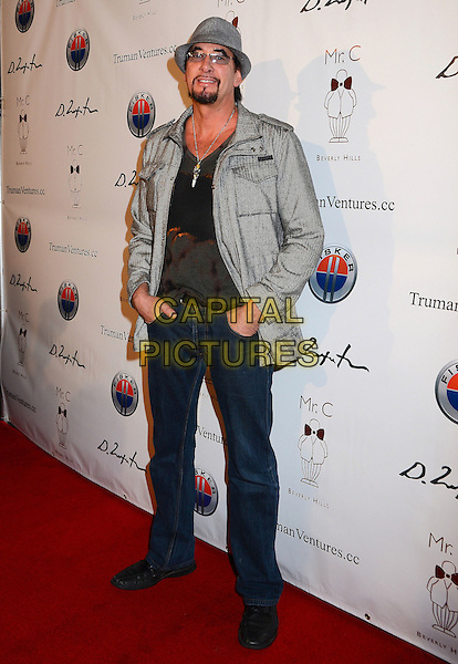 Ralph Rieckerman.Mr. C Beverly Hills Hosts Domingo Zapata's Oscar Art Show at Mr. C Beverly Hills, California, USA..February 22nd, 2012.full length black top grey gray hat jacket jeans denim.CAP/ADM/BT.©Birdie Thompson/AdMedia/Capital Pictures.