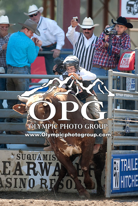 28 Aug 2011:  Jake Wood was not able to score while riding the bull Dr. Feelgood in the Seminole Hard Rock Extreme Bulls competition  held at the Kitsap County Fair and Stampede Rodeo in Bremerton, Washington.