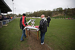 Cefn Druids AFC 1 Buckley Town 0, 12/04/2014. The Rock, Cymru Alliance league. The league trophy being taken onto the pitch at The Rock, Rhosymedre, home to Cefn Druids AFC, at the end of the club's final home game of the season against Buckley Town (in yellow) in the Cymru Alliance league. Druids, reputedly the oldest football club in Wales, won the Alliance league the previous week and were awarded the trophy after the Buckley Town match, which they won by 1 goal to nil, watched by a crowd of 246. The Cymru Alliance was the second tier of Welsh football based in north and mid Wales, promotion from which led directly into the Welsh Premier League. Photo by Colin McPherson.