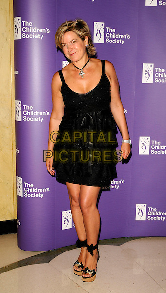 PENNY SMITH.The Annual Fairytale Ball, Claridges Hotel, London, England..May 21st, 2008.full length black dress wedges wooden stack heel shoes layers layered ribbon bow .CAP/CAN.©Can Nguyen/Capital Pictures.