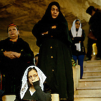 Egypt / Cairo / 6.1.2013 / Women during the Coptic Christmas celebrations at a cave chapel. The chapel is part of the Simon the Tanner Monastery, hidden in a cave in the Mokattam hills, above Cairo's Manshiyet Nasser (also known as Garbage City, Zabbaleen's settlement). © Giulia Marchi