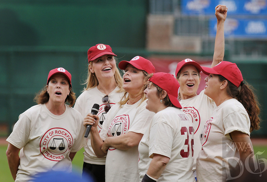 Actors who played members of the Rockford Peaches team in 'A League of Their Own' sing the All-American Girls Professional Baseball League victory song made famous in the movie on Sunday May 8, 2016 during the 2nd annual Bentonville Film Festival 'A League of Their Own' reunion softball game at Arvest Ballpark in Springdale. From left, Patti Pelton, Geena Davis, Freddie Simpson, Megan Cananagh, Anne Ramsay and Tracy Reiner.