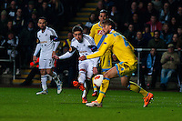 Swansea, UK. Thursday 20 February 2014<br /> Pictured: Swansea's Pablo Hernandez takes a shot at goal only to be blocked by Henrique  of Napoli<br /> Re: UEFA Europa League, Swansea City FC v SSC Napoli at the Liberty Stadium, south Wales, UK