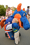 Garden City, New York, U.S. - June 6, 2014 - OLIVER PAPP, 18-months-old, of Garden City, hugs SPARKY THE DRAGON, the New York Islanders mascot, at the Garden City Belmont Stakes Festival, celebrating the 146th running of Belmont Stakes at nearby Elmont the next day. There was street festival family fun with live bands, food, pony rides and more, and a main sponsor of this Long Island night event was The New York Racing Association Inc.