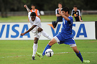 Joseph Gyau (13) of the USA takes a shot past Dylan Serrano (4) of the Academy Select Team. The US U-17 defeated the Academy Select team 3-1 during day one of the US Soccer Development Academy  Spring Showcase in Sarasota, FL, on May 22, 2009.