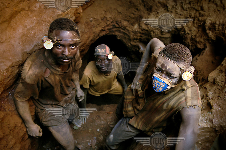 Young men dig for copper at a mine near Lubumbashi, the mining capital of Congo. .
