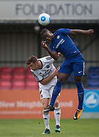 Marc Guehi of Chelsea U23 heads clear of Matt McClure of Aldershot Town during the pre season friendly match between Aldershot Town and Chelsea U23 at the EBB Stadium, Aldershot, England on 19 July 2017. Photo by Andy Rowland / PRiME Media Images.