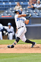 Asheville Tourists catcher Javier Guevara (9) swings at a pitch during a game against the Augusta GreenJackets at McCormick Field on April 7, 2019 in Asheville, North Carolina. The GreenJackets  defeated the Tourists 11-2. (Tony Farlow/Four Seam Images)