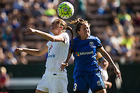 Seattle, WA - Sunday, May 1, 2016: FC Kansas City midfielder Mandy Laddish (7) and Seattle Reign FC defender Lauren Barnes (3) go up for a header during a National Women's Soccer League (NWSL) match at Memorial Stadium.