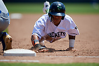 Augusta GreenJackets Ismael Munguia (34) dives back to first base on a pickoff attempt uring a South Atlantic League game against the Lexington Legends on April 30, 2019 at SRP Park in Augusta, Georgia.  Augusta defeated Lexington 5-1.  (Mike Janes/Four Seam Images)