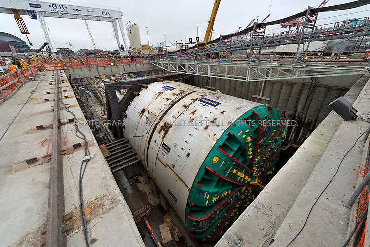 7/20/2013--Seattle, WA, USA<br /> <br /> &quot;Big Bertha&quot;, the massive deep bore tunneling machine, will soon start escalating under Seattle building a 1.7 mile tunnel to replace the aging Alaskan Way Viaduct on Highway 99. The drill is the largest ever built and when finished with allow 4 lanes of traffic to bypass downtown Seattle.<br /> <br /> The $80 million dollar machine was built in Japan by Hitachi-Zosen and is 57 feet, 4 inches in diameter and 322 feet long.<br /> <br /> WSDOT plans to complete the $2 billion tunnel by late 2015 with funding from gas taxes and later, tolls.<br /> <br /> <br /> &copy;2013 Stuart Isett. All rights reserved.