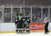 North Dakota celebrates Corban Knight's goal during the second period. North Dakota beat Nebraska-Omaha 5-2 in the outdoor game at TD Ameritrade Park on Saturday, Feb. 9, 2013. (Photo by Michelle Bishop)
