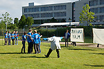 International youth delegates in Bonn at the United Nations Climate Talks engage in a football match. The match had a specific set of rules to highlight the inequity between the north and the south in these talks. The blue shirts represent the Northern, developed nations and they vastly outnumber the southern representatives. The North was allowed to cheat and hold secret meetings while the south was prohibited from scoring and forced to quickly explain complicated acronyms. This action highlights the overwhelming disparity between the northern interests and the soutern interests.(©Robert vanWaarden)