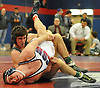 Bailey O'Brien of Locust Valley, top, controls Cold Spring Harbor's Zak Hodgson during a 170 pound bout in the Nassau County Division II varsity wrestling finals at Cold Spring Harbor High School on Saturday, Feb. 10, 2018. O'Brien won the match for his third county championship.