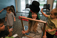 NWA Democrat-Gazette/CHARLIE KAIJO Chloe Burgett, associate museum educator, (center) plays with preschoolers during a preschool costume event, Thursday, September 13, 2018 at Crystal Bridges in Bentonville.<br /><br />Kids had the opportunity to create stories with creative play and outfits.