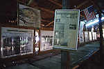 Inside a replica of a bamboo and thatch hut that was used as prison housing during World War II, are newspaper articles, paintings, photos and sketches depicting the horror that was in Kanchanaburi, Thailand. Over 16,000 allied P.O.W.s died of starvation, maltreatment and disease while building the bridge on the River Kwai and a 250- mile railway from Thailand into Burma. The Bridge on the River Kwai, known to many P.O.W.'s as the bridge of sorrow, attracts thousands of tourists yearly. (Jim Bryant Photo).....