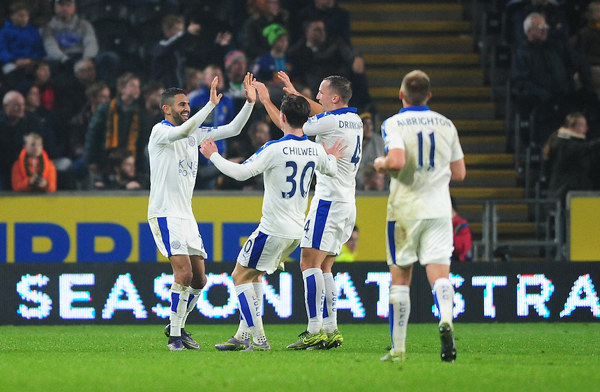 Leicester City's Riyad Mahrez, left, celebrates scoring the opening goal with team-mates Ben Chilwell and Daniel Drinkwater<br /> <br /> Photographer Chris Vaughan/CameraSport<br /> <br /> Football - Capital One Cup Round 4 - Hull City v Leicester City - Tuesday 27th October 2015 - Kingston Communications Stadium - Hull<br />  <br /> &copy; CameraSport - 43 Linden Ave. Countesthorpe. Leicester. England. LE8 5PG - Tel: +44 (0) 116 277 4147 - admin@camerasport.com - www.camerasport.com