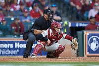 Arkansas Razorbacks catcher Casey Opitz (12) sets a target as home plate umpire Michael Banks looks on during the game against the Oklahoma Sooners in game two of the 2020 Shriners Hospitals for Children College Classic at Minute Maid Park on February 28, 2020 in Houston, Texas. The Sooners defeated the Razorbacks 6-3. (Brian Westerholt/Four Seam Images)