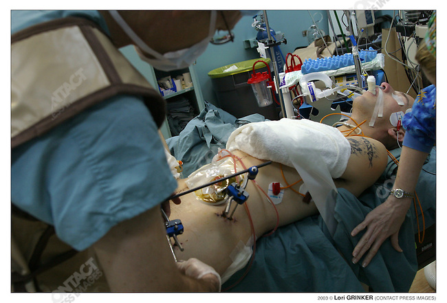 26 year old marine Sgt. Jose Torres, who was severely wounded in Nasaryia, in surgery. USNS COMFORT Naval hospital ship in the Persian Gulf.