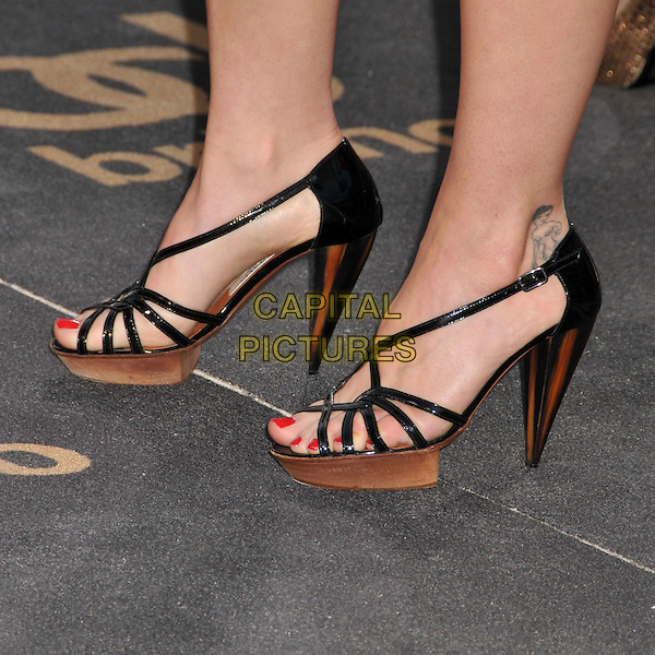 "CHRISTINA RICCI'S SHOES .""Bruno"" Los Angeles Premiere held at Grauman's Chinese Theatre, Hollywood, CA, USA..June 25th, 2009 .feet heels wood wooden platform sandals black straps red nail varnish polish tattoo.CAP/ADM/BP.©Byron Purvis/AdMedia/Capital Pictures."