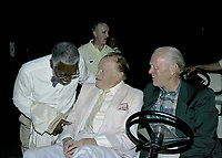 Winston-Salem, North Carolina, USA, May 31, 1991<br /> Bob Hope and Former President Gerald R. Ford sit in a golf cart while greeting fans and guests at the annual Bill Crosby Clambake Golf Tournament at the Bermuda Run Country Club. Jazz singer Joe WIlliams greets Hope and Ford Credit: Mark Reinstein/MediaPunch