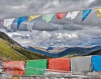 Prayer flags waving in the breeze in the Drolma Valley, a high valley at ~15,500 ft. in central Tibet.