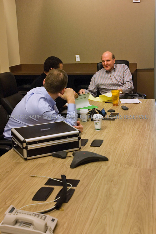 1/23/2006--Redmond, WA, USA..10:59am: Steve Ballmer (right), CEO of Microsoft, meeting in a 5th floor conference room with Pieter Knook (front), senior VP, Mobile and Embedded Devices Division & Communications sector and Todd Warren (center, black short), Corporate VP, Mobile and Embedded Devices...Robert Bach, President, Entertainment and Devices Division also attended (unseen). Ballmer was meeting with Microsoft's mobile device team to review product plans and the development, marketing and sales of software for devices such as mobile phones, personal digital assistants, portable media players, televisions and devices in cars...Photograph ©2007 Stuart Isett.All rights reserved