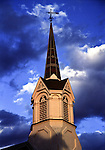 A church spire with weather vane