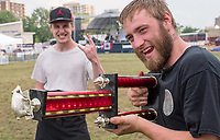 Jack the Ribber barkers Wesley Yates, left and Josh McQuiggan blast into Ribfest<br /> <br /> <br /> It got off to a slow, wet start, but rib lovers still made their way to Centennial Park for the opening of Ribfest, Thursday evening. The event is held by the Sarnia Kinsmen Club and features ribs from six vendors, music and entertainment. Ribfest continues until Sunday.