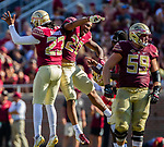 Florida State kicker Ricky Aguayo (23) and Keyshawn Helton celebrate Aguayo's 50 yard field goal vs Northern Illinois University on September 22, 2018 in Tallahassee, Florida.  The Seminoles defeated the Huskies 37-19.