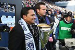 07 December 2013: Former Kansas City greats Diego Gutierrez (left) and Chris Klein (right) carry the Philip F. Anschutz Trophy onto the field before the game. MLS Cup 2013 was played between Sporting Kansas City and Real Salt Lake at Sporting Park in Kansas City, Kansas. Sporting Kansas City won the championship by winning the penalty kick shootout 7-6 after the game ended in a 1-1 tie.