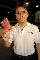 "Referee Shinsuke Funabashi. He is holding a card saying ""break"" which he uses during bouts involving wrestlers with hearing disabilities."