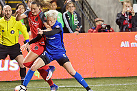 Portland, OR - Saturday May 06, 2017: Celeste Boureille, Megan Rapinoe during a regular season National Women's Soccer League (NWSL) match between the Portland Thorns FC and the Chicago Red Stars at Providence Park.