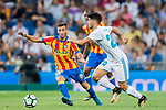 Marco Asensio Willemsen (r) of Real Madrid battles for the ball with Jose Luis Gaya Pena of Valencia CF during their La Liga 2017-18 match between Real Madrid and Valencia CF at the Estadio Santiago Bernabeu on 27 August 2017 in Madrid, Spain. Photo by Diego Gonzalez / Power Sport Images