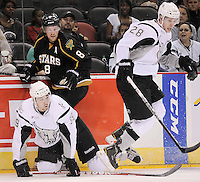 San Antonio Rampage's Justin Vaive, left, and Texas Stars' Jordie Benn (8) collide along the boards as Rampage's James Wright jumps to avoid them during the first period of an AHL hockey game, Saturday, Oct. 13, 2012, in San Antonio. Texas won 2-1. (Darren Abate/pressphotointl.com)