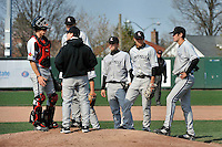 Louisville Cardinals catcher J.J. Ethel (35) tries to calm his pitcher Matt Koch (20) while manager Dan McDonnell comes out to talk during a game against the St.John's Red Storm at Jack Kaiser Stadium in Queens, New York;  April 15, 2011.  St. John's defeated Louisville 8-2.  Photo By Tomasso DeRosa/Four Seam Images
