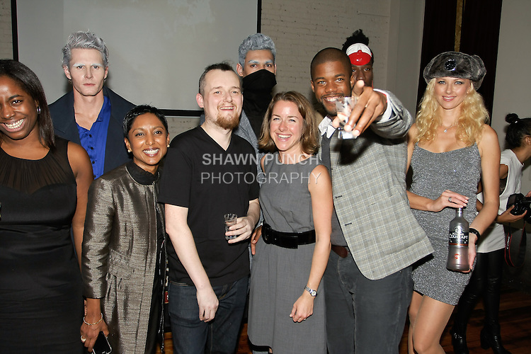 (Front left to right) Rasheda Perry, Sumindi Peiris, William Watson, Allison Varone, and ZM Wright poses with models, at the William Watson Spring Summer 2012 fashion presentation on October 27, 2011.