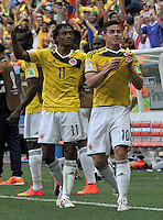 BRASILIA - BRASIL -19-06-2014. James Rodríguez (Der) jugador de Colombia (COL) celebra un gol anotado a Costa de Marfil (CIV) durante partido del Grupo C de la Copa Mundial de la FIFA Brasil 2014 jugado en el estadio Mané Garricha de Brasilia./ James Rodriguez (R) player of Colombia (COL) celebrates a goal scored to Ivory Coast (CIV) during the macth of the Group C of the 2014 FIFA World Cup Brazil played at Mane Garricha stadium in Brasilia. Photo: VizzorImage / Alfredo Gutiérrez / Contribuidor