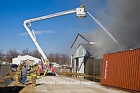 63818-02302 Firefighters extinguishing warehouse fire using aerial ladder truck, Salem, IL