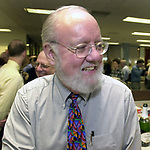 Paul Schreiber, at champagne get together of Newsday staff in the City room to toast the departure of colleagues on Friday March 1, 2002. (Photo by Jim Peppler).