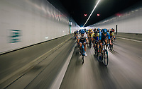 "peloton crossing the tunnel under the Antwerp harbour/port<br /> <br /> Antwerp Port Epic 2018 (formerly ""Schaal Sels"")<br /> One Day Race:  Antwerp > Antwerp (207 km; of which 32km are cobbles & 30km is gravel/off-road!)"