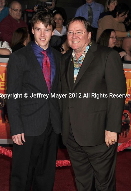 LOS ANGELES, CA - FEBRUARY 22: John Lasseter and son attend the 'John Carter' Los Angeles premiere held at the Regal Cinemas L.A. Live on February 22, 2012 in Los Angeles, California.