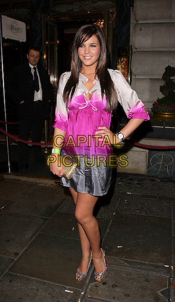 DANIELLE LLOYD.Launch Party for Sue Moxley and Cheryl Carter Make Up range at Paper Nightclub, Regent Street, London, England. .November 1st 2007.full length white pink grey gray fade dress gold bag clutch  purse hand on hip silver shoes .CAP/ROS.©Steve Ross/Capital Pictures