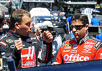 Apr 17, 2009; Avondale, AZ, USA; NASCAR Sprint Cup Series driver Ryan Newman (left) talks with teammate Tony Stewart during practice for the Subway Fresh Fit 500 at Phoenix International Raceway. Mandatory Credit: Mark J. Rebilas-