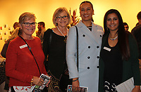 NWA Democrat-Gazette/CARIN SCHOPPMEYER Kathleen Barta (from left), Celestine Eichler, Lulu Valverde and Shabana Kauser, 5x5 artists, gather at the Arts Center of the Ozarks 5x5 Soiree and Auction on Oct. 26 at the center in Springdale.